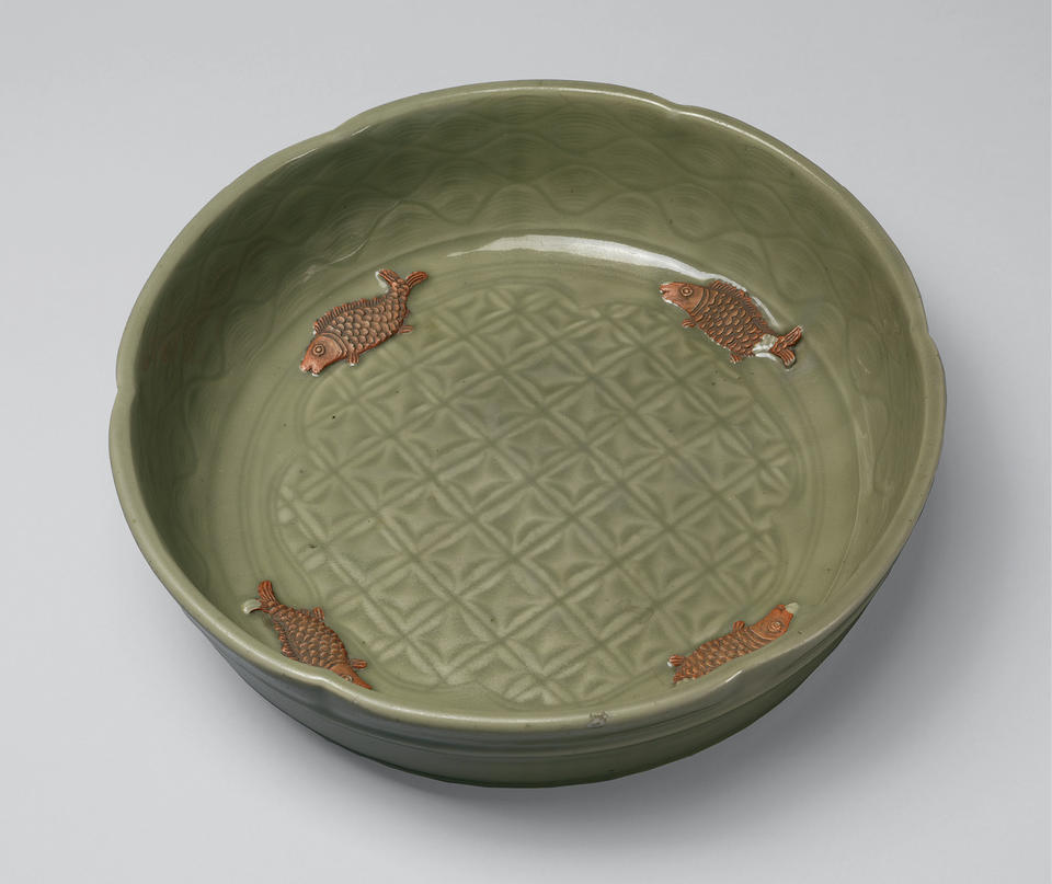 Basin with incised decoration and applied fish