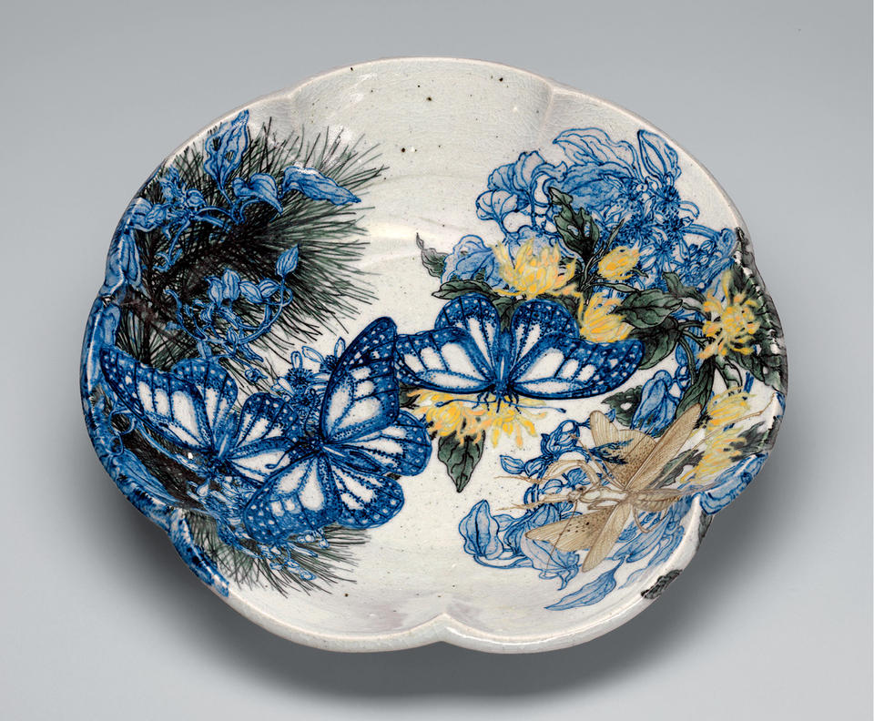 Bowl with butterflies, pine boughs, and flowers