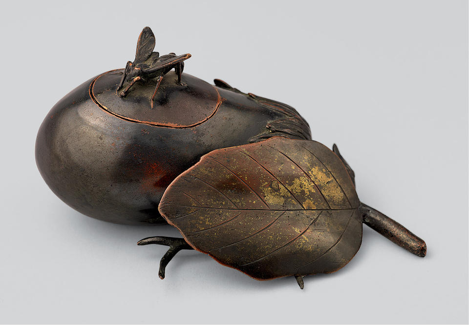 Incense burner in the shape of an eggplant with an insect