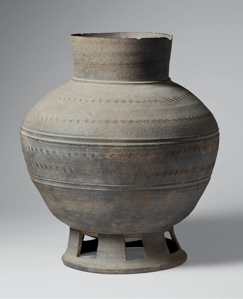 Long-necked jar with perforated base
