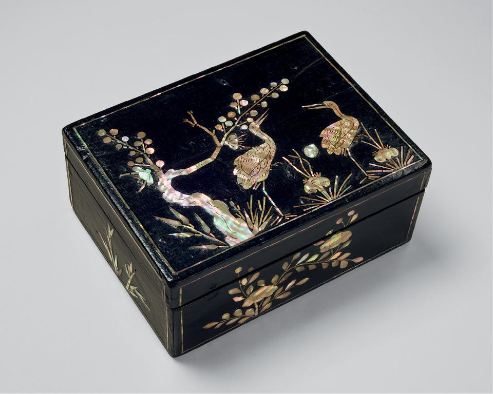 Box with cranes and plum tree